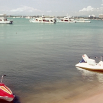 Tourist boats and retro jet skis in Pattaya Bay